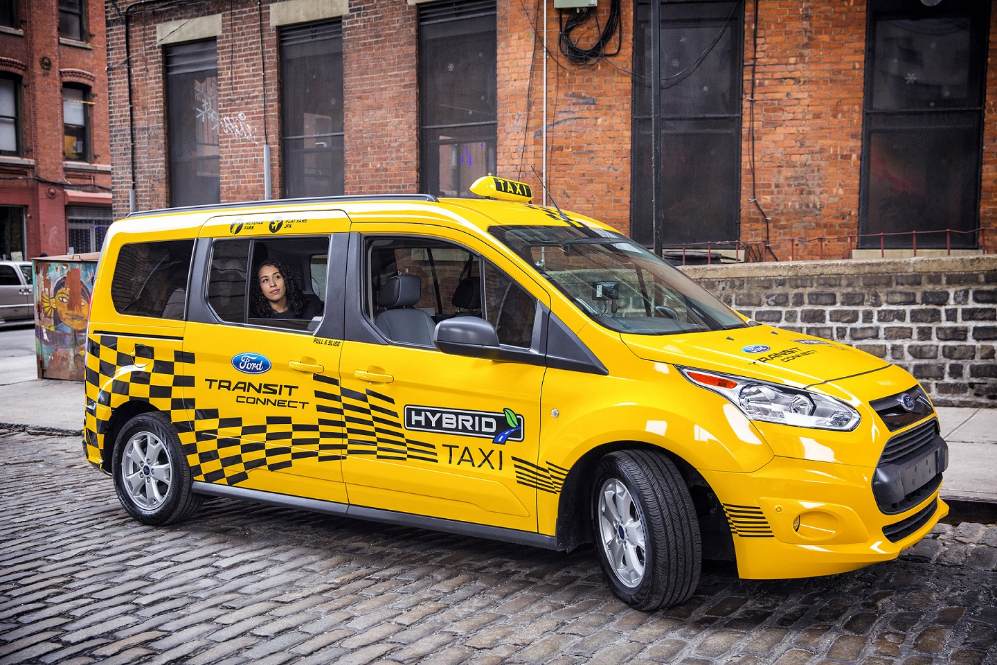 A passenger takes a ride in the new Ford Transit Connect hybrid taxi prototype. Ford will start testing a fleet of 20 Transit Connect hybrid taxi and van prototypes in major cities across the U.S. this year to help businesses reduce their operating costs while still providing plenty of passenger and cargo space.